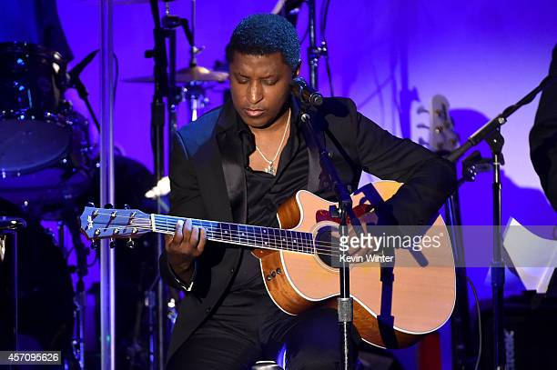 Recording artist Kenneth 'Babyface' Edmonds performs onstage at the 2014 Carousel of Hope Ball presented by MercedesBenz at The Beverly Hilton Hotel...