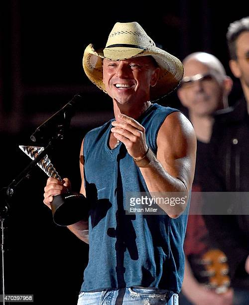Recording artist Kenny Chesney accepts the Milestone Award for First FanVoted ACM Entertainer of the Year onstage during the 50th Academy of Country...