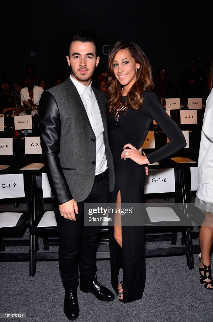 Recording artist Kevin Jonas and Danielle Jonas attend Pamella Roland during Fall 2013 Mercedes-Benz Fashion Week at The Studio at Lincoln Center on February 11, 2013 in New York City.