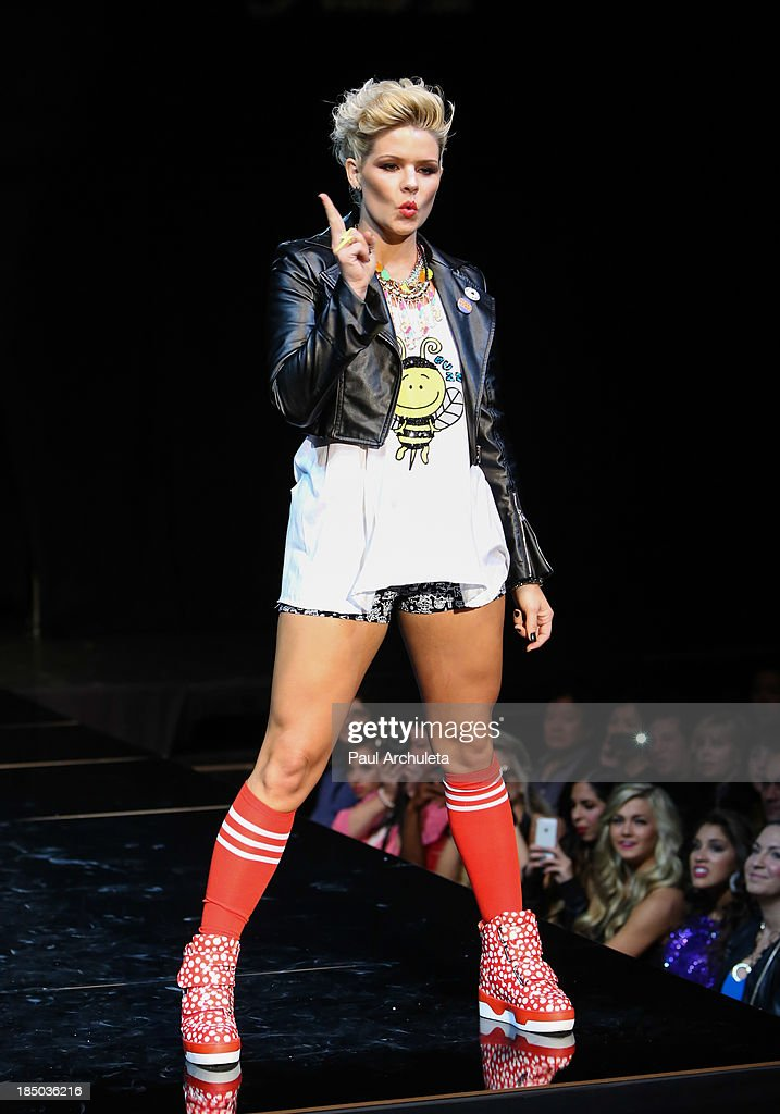 Recording Artist Kimberly Caldwell walks the runway at iiJin's spring/summer 2014 'The Glamorous Life' fashion show at Avalon on October 16 2013 in...