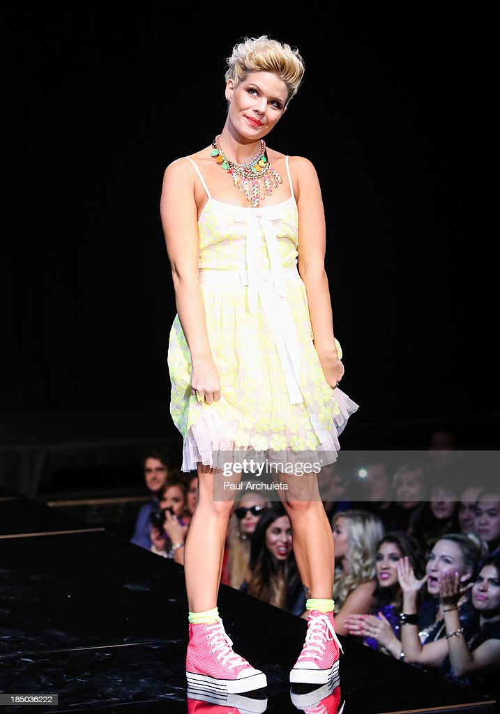 Recording Artist Kimberly Caldwell walks the runway at iiJin's spring/summer 2014 'The Glamorous Life' fashion show at Avalon on October 16, 2013 in Hollywood, California.