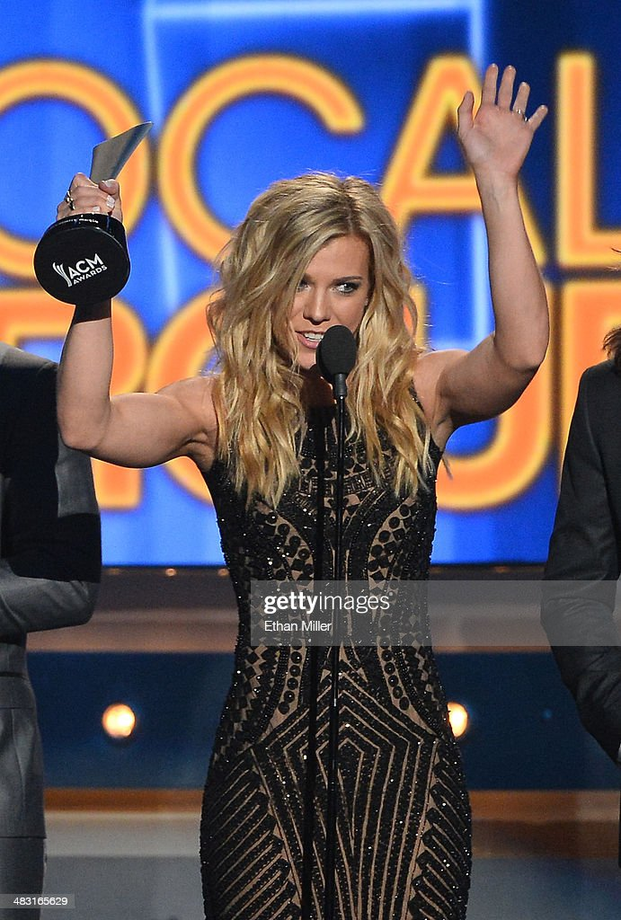 Recording artist Kimberly Perry of The Band Perry accepts the Vocal Group of the Year award onstage during the 49th Annual Academy of Country Music Awards at the MGM Grand Garden Arena on April 6, 2014 in Las Vegas, Nevada.