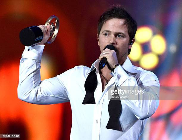 Recording artist Kip Moore accepts the Breakthrough Artist of the Year award onstage during the 2014 American Country Countdown Awards at Music City...