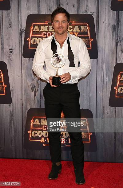 Recording artist Kip Moore winner of the Breakthrough Artist of the Year award poses in the press room during the 2014 American Country Countdown...