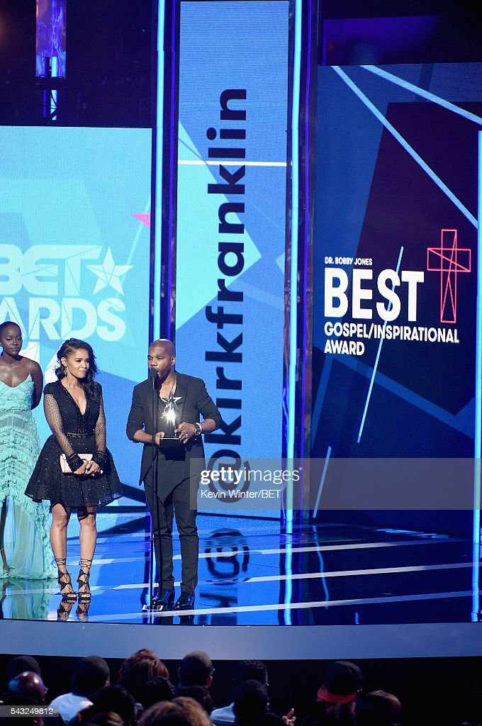 Recording artist <a gi-track='captionPersonalityLinkClicked' href=/galleries/search?phrase=Kirk+Franklin&family=editorial&specificpeople=779291 ng-click='$event.stopPropagation()'>Kirk Franklin</a> (R) accepts the Best Gospel/Inspirational award onstage as Tammy Collins looks on during the 2016 BET Awards at the Microsoft Theater on June 26, 2016 in Los Angeles, California.