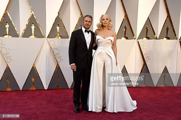 Recording artist Lady Gaga and actor Taylor Kinney attend the 88th Annual Academy Awards at Hollywood Highland Center on February 28 2016 in...