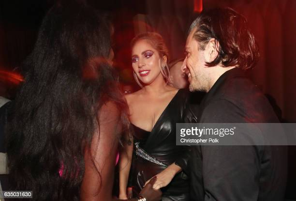 Recording artist Lady Gaga and Christian Carino attend Interscope's Grammy After Party with Lady Gaga at the Peppermint Club on February 12 2017 in...