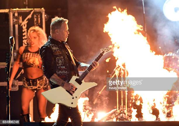 Recording artist Lady Gaga and recording artist James Hetfield of music group Metallica perform onstage during The 59th GRAMMY Awards at STAPLES...