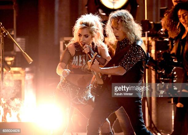 Recording artist Lady Gaga and recording artist Kirk Hammett of music group Metallica perform onstage during The 59th GRAMMY Awards at STAPLES Center...