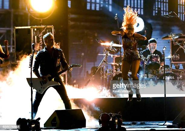Recording artist Lady Gaga and recording artists James Hetfield and Lars Ulrich of music group Metallica perform onstage during The 59th GRAMMY...