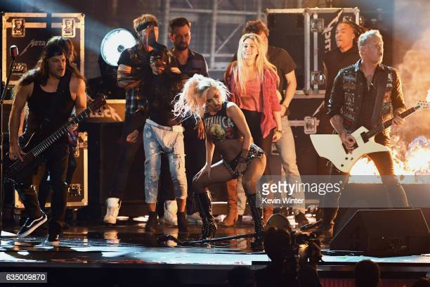 Recording artist Lady Gaga and recording artists Robert Trujillo and James Hetfield of music group Metallica perform onstage during The 59th GRAMMY...