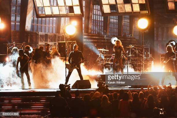 Recording artist Lady Gaga and recording artists Robert Trujillo James Hetfield and Kirk Hammett of music group Metallica perform onstage during The...