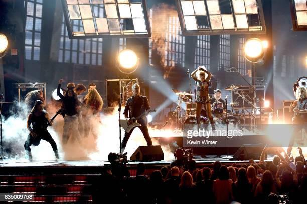 Recording artist Lady Gaga and recording artists Robert Trujillo James Hetfield Lars Ulrich and Kirk Hammett of music group Metallica perform onstage...
