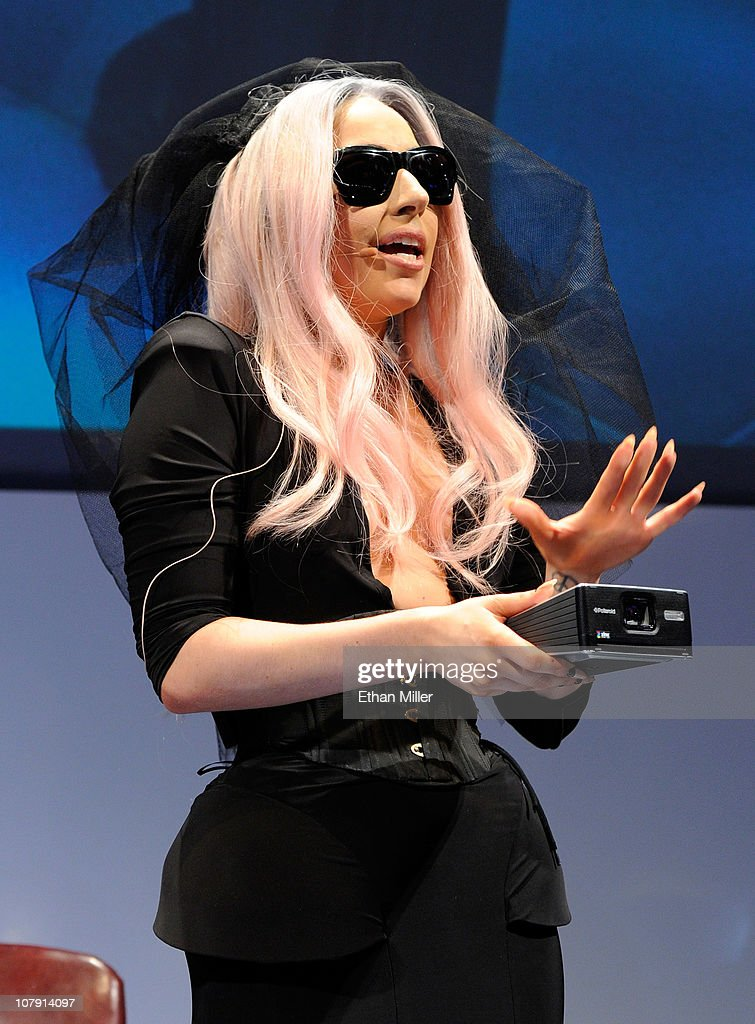 Recording artist <a gi-track='captionPersonalityLinkClicked' href=/galleries/search?phrase=Lady+Gaga&family=editorial&specificpeople=4456754 ng-click='$event.stopPropagation()'>Lady Gaga</a> displays the GL30 Instant Digital Camera as she unveils the Polaroid Grey Label of products she co-designed at the 2011 International Consumer Electronics Show at the Las Vegas Convention Center January 6, 2011 in Las Vegas, Nevada. <a gi-track='captionPersonalityLinkClicked' href=/galleries/search?phrase=Lady+Gaga&family=editorial&specificpeople=4456754 ng-click='$event.stopPropagation()'>Lady Gaga</a> serves as Polaroid's creative director and also helped introduce a mobile printer and camera glasses. CES, the world's largest annual consumer technology trade show, runs through January 9 and is expected to feature 2,700 exhibitors showing off their latest products and services to about 126,000 attendees.