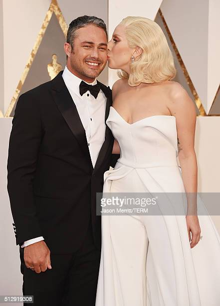 Recording artist Lady Gaga kisses actor Taylor Kinney at the 88th Annual Academy Awards at Hollywood Highland Center on February 28 2016 in Hollywood...
