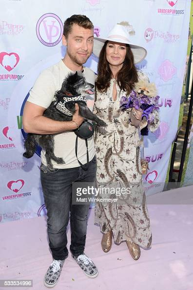 Recording artist Lance Bass and TV personality Lisa Vanderpump attend the World Dog Day Celebration at The City of West Hollywood Park on May 22 2016...