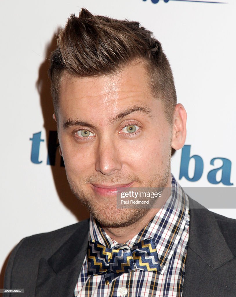 Recording artist Lance Bass arrives at 'Tie The Knot' Store Grand Opening with founder Jesse Tyler Ferguson at The Beverly Center on December 5, 2013 in Los Angeles, California.