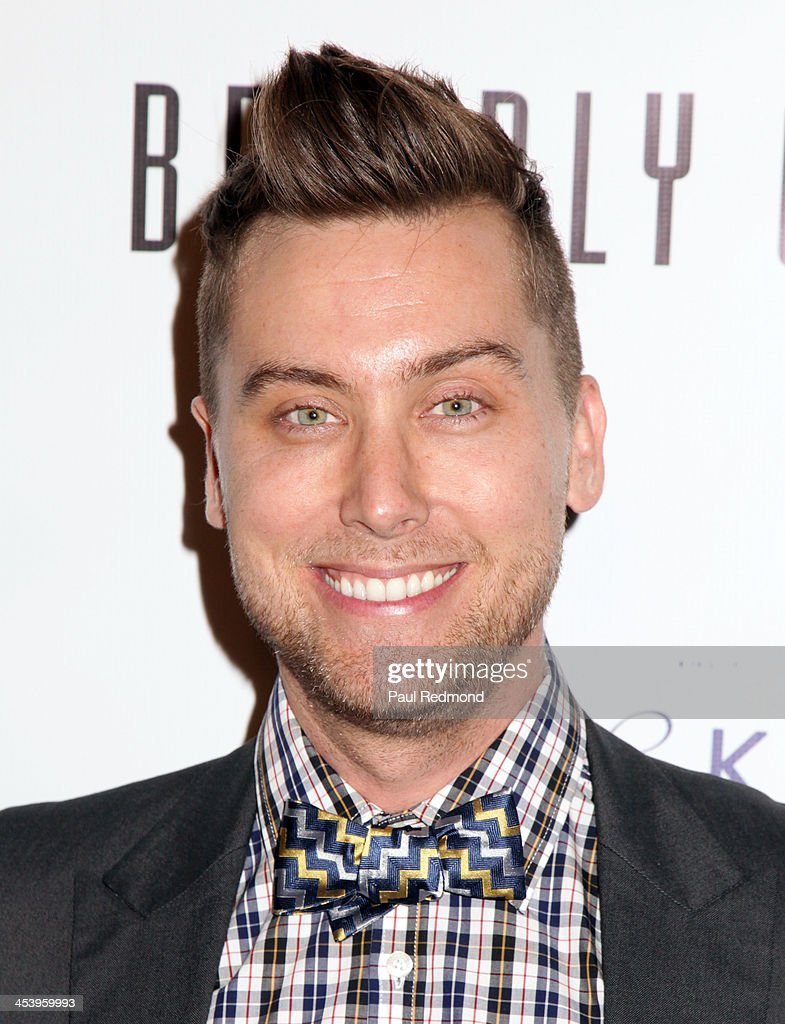 Recording artist <a gi-track='captionPersonalityLinkClicked' href=/galleries/search?phrase=Lance+Bass&family=editorial&specificpeople=210566 ng-click='$event.stopPropagation()'>Lance Bass</a> arrives at 'Tie The Knot' Store Grand Opening with founder Jesse Tyler Ferguson at The Beverly Center on December 5, 2013 in Los Angeles, California.