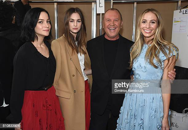 Recording Artist Leigh Lezark model Laura Love designer Michael Kors and DJ Harley VieraNewton pose backstage at the Michael Kors Fall 2016 Runway...