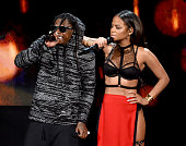 Recording artist Lil Wayne and actress/recording artist Christina Milian perform onstage at the 2014 American Music Awards at Nokia Theatre LA Live...