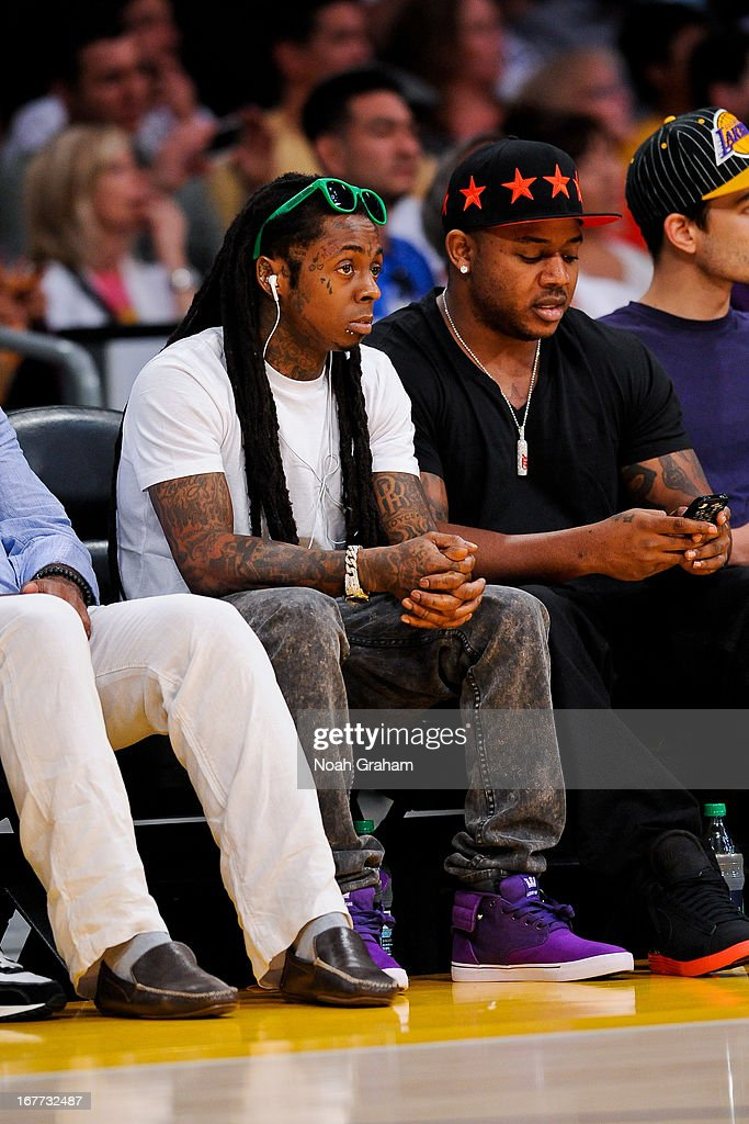 Recording artist Lil Wayne looks on as the San Antonio Spurs play the Los Angeles Lakers in Game Four of the Western Conference Quarterfinals during the 2013 NBA Playoffs at Staples Center on April 28, 2013 in Los Angeles, California.