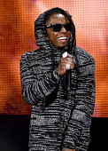 Recording artist Lil Wayne performs onstage at the 2014 American Music Awards at Nokia Theatre LA Live on November 23 2014 in Los Angeles California