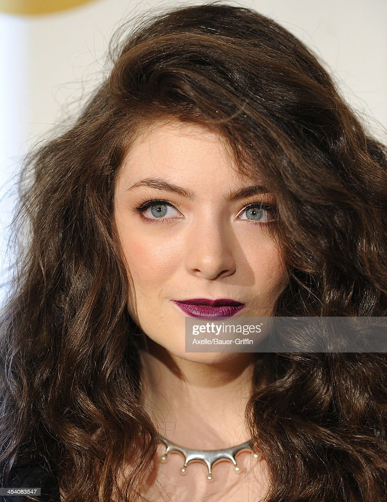 Recording artist Lorde poses in the press room at The GRAMMY Nominations Concert Live! Countdown To Music's Biggest Night at Nokia Theatre L.A. Live on December 6, 2013 in Los Angeles, California.