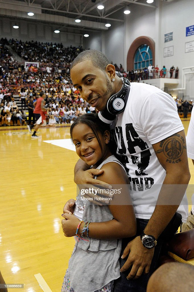 Recording Artist <a gi-track='captionPersonalityLinkClicked' href=/galleries/search?phrase=Ludacris&family=editorial&specificpeople=203034 ng-click='$event.stopPropagation()'>Ludacris</a> and his daughter Karma attend the 2011 LudaDay Weekend on September 4, 2011 in Atlanta, Georgia.