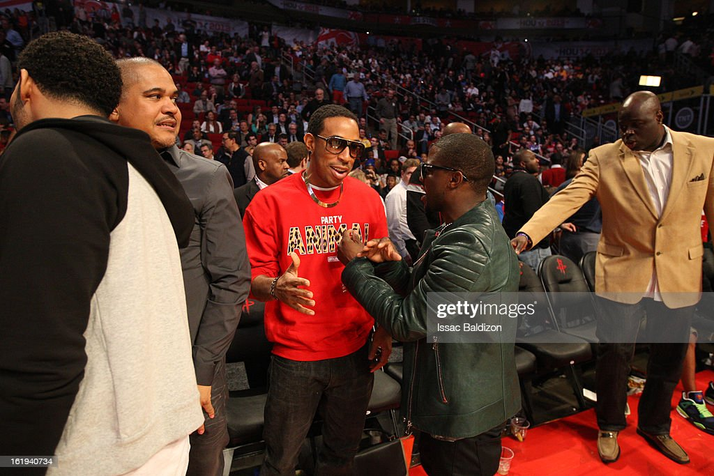 Recording artist, Ludacris, shares a laugh with comedian Kevin Hart after the 2013 NBA All-Star Game on February 17, 2013 at Toyota Center in Houston, Texas.