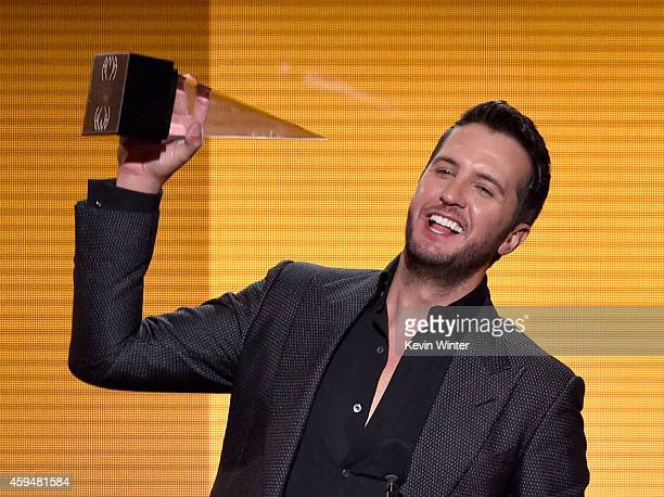 Recording artist Luke Bryan accepts the Favorite Country Male Artist award onstage at the 2014 American Music Awards at Nokia Theatre LA Live on...