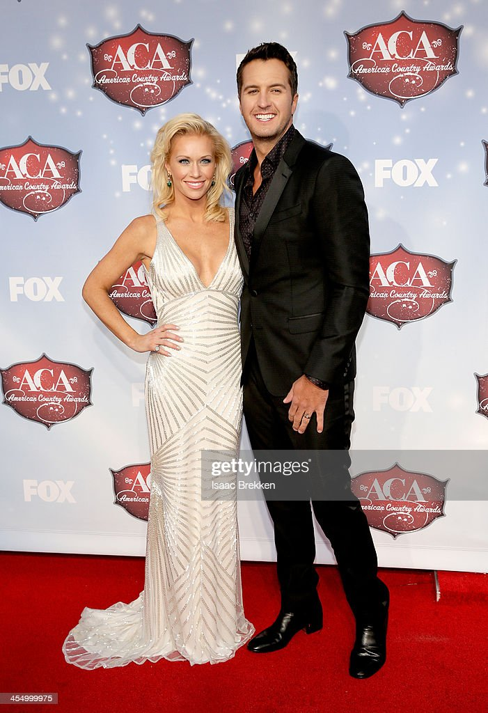Recording artist Luke Bryan (R) and Caroline Boyer arrive at the American Country Awards 2013 at the Mandalay Bay Events Center on December 10, 2013 in Las Vegas, Nevada.
