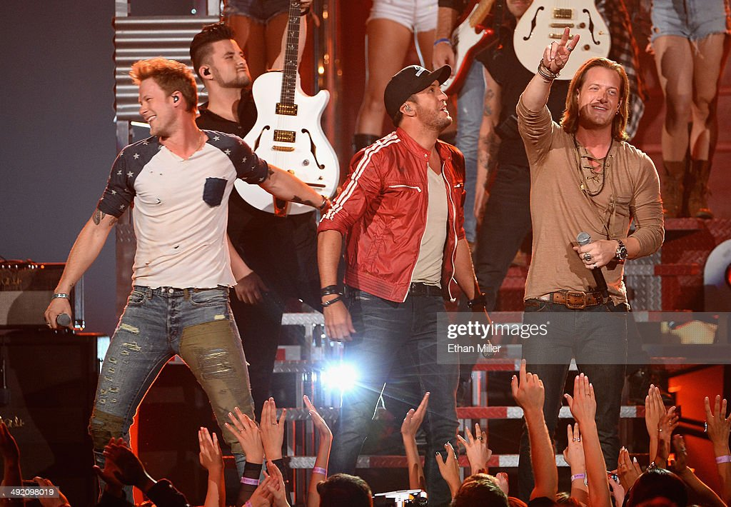 Recording artist <a gi-track='captionPersonalityLinkClicked' href=/galleries/search?phrase=Luke+Bryan&family=editorial&specificpeople=4001956 ng-click='$event.stopPropagation()'>Luke Bryan</a> (C) and Florida Georgia Line members Brian Kelley (L) and <a gi-track='captionPersonalityLinkClicked' href=/galleries/search?phrase=Tyler+Hubbard&family=editorial&specificpeople=9453787 ng-click='$event.stopPropagation()'>Tyler Hubbard</a> (R) perform onstage during the 2014 Billboard Music Awards at the MGM Grand Garden Arena on May 18, 2014 in Las Vegas, Nevada.