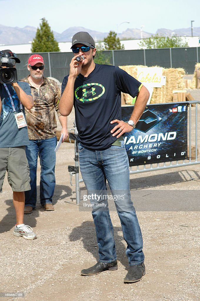 Recording artist <a gi-track='captionPersonalityLinkClicked' href=/galleries/search?phrase=Luke+Bryan&family=editorial&specificpeople=4001956 ng-click='$event.stopPropagation()'>Luke Bryan</a> attends the 48th Annual Academy Of Country Music Awards & Cabela's Great Outdoors Archery event at the Orleans Arena on April 6, 2013 in Las Vegas, Nevada.