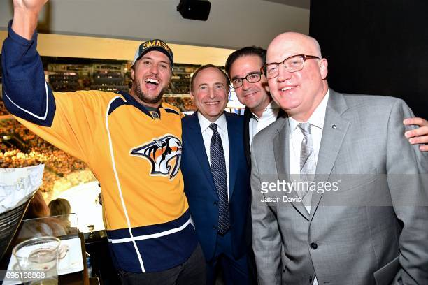 Recording Artist Luke Bryan NHL Commissioner Gary Bettmann NHL Chief Content Officer Steve Mayer and NHL Deputy Commissioner Bill Daly attend the...