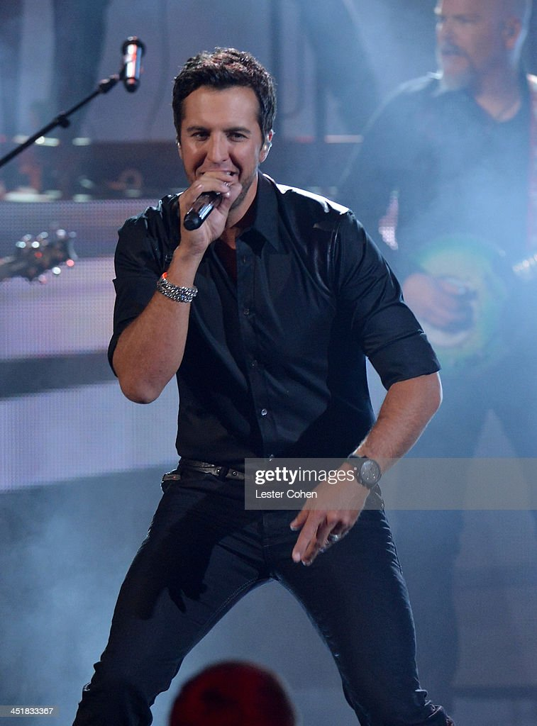 Recording artist <a gi-track='captionPersonalityLinkClicked' href=/galleries/search?phrase=Luke+Bryan&family=editorial&specificpeople=4001956 ng-click='$event.stopPropagation()'>Luke Bryan</a> performs onstage during the 2013 American Music Awards at Nokia Theatre L.A. Live on November 24, 2013 in Los Angeles, California.