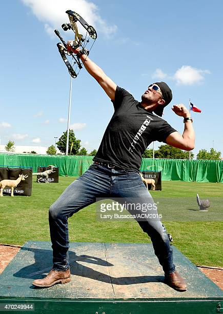 Recording artist Luke Bryan poses with a trophy at the ACM Cabela's Great Outdoor Archery Event during the 50th Academy of Country Music Awards at...