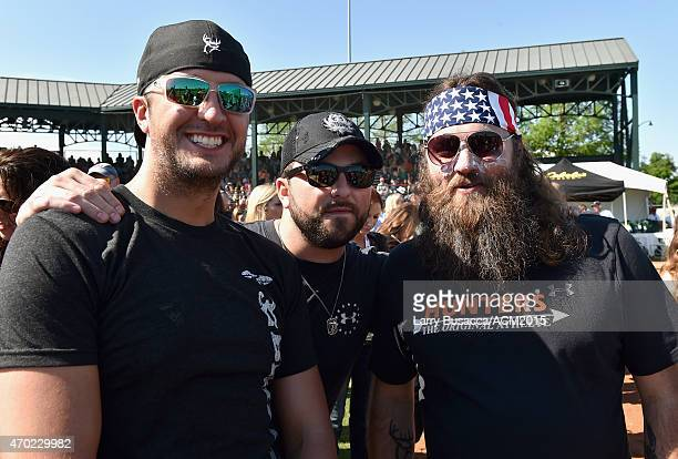 Recording artist Luke Bryan recording artist Tyler Farr and TV personality Willie Robertson attend the ACM Cabela's Great Outdoor Archery Event...