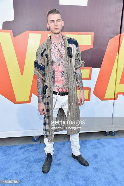 Recording artist Machine Gun Kelly attends The 2015 MTV Movie Awards at Nokia Theatre LA Live on April 12 2015 in Los Angeles California