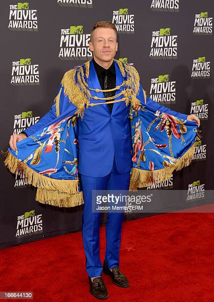 Recording artist Macklemore arrives at the 2013 MTV Movie Awards at Sony Pictures Studios on April 14 2013 in Culver City California