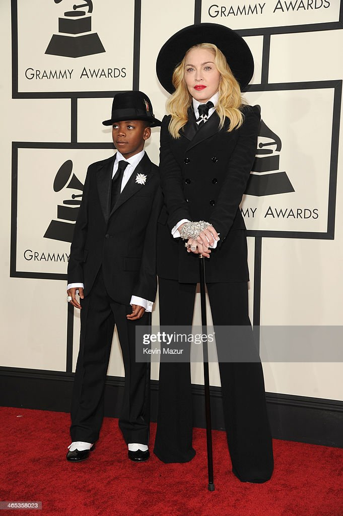 Recording artist Madonna (R) and David Banda attend the 56th GRAMMY Awards at Staples Center on January 26, 2014 in Los Angeles, California.