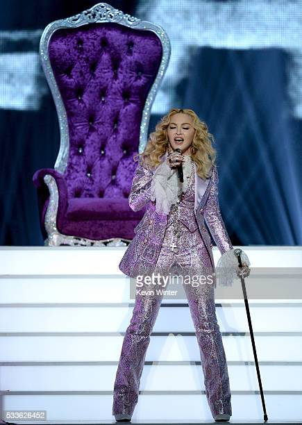 Recording artist Madonna performs a tribute to Prince onstage during the 2016 Billboard Music Awards at TMobile Arena on May 22 2016 in Las Vegas...