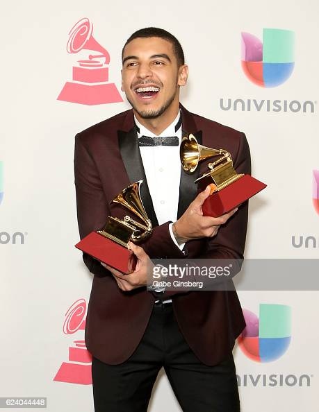 Recording artist Manuel Medrano poses with the Best SingerSongwriter Album and Best New Artist awards in the press room during The 17th Annual Latin...