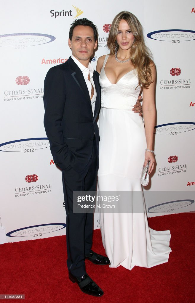 Recording artist <a gi-track='captionPersonalityLinkClicked' href=/galleries/search?phrase=Marc+Anthony&family=editorial&specificpeople=202544 ng-click='$event.stopPropagation()'>Marc Anthony</a> (L) and Shannon De Lima attend the 27th Annual Cedars-Sinai Medical Center Sports Spectacular at the Hyatt Regency Century Plaza hotel on May 20, 2012 in Century City, California.