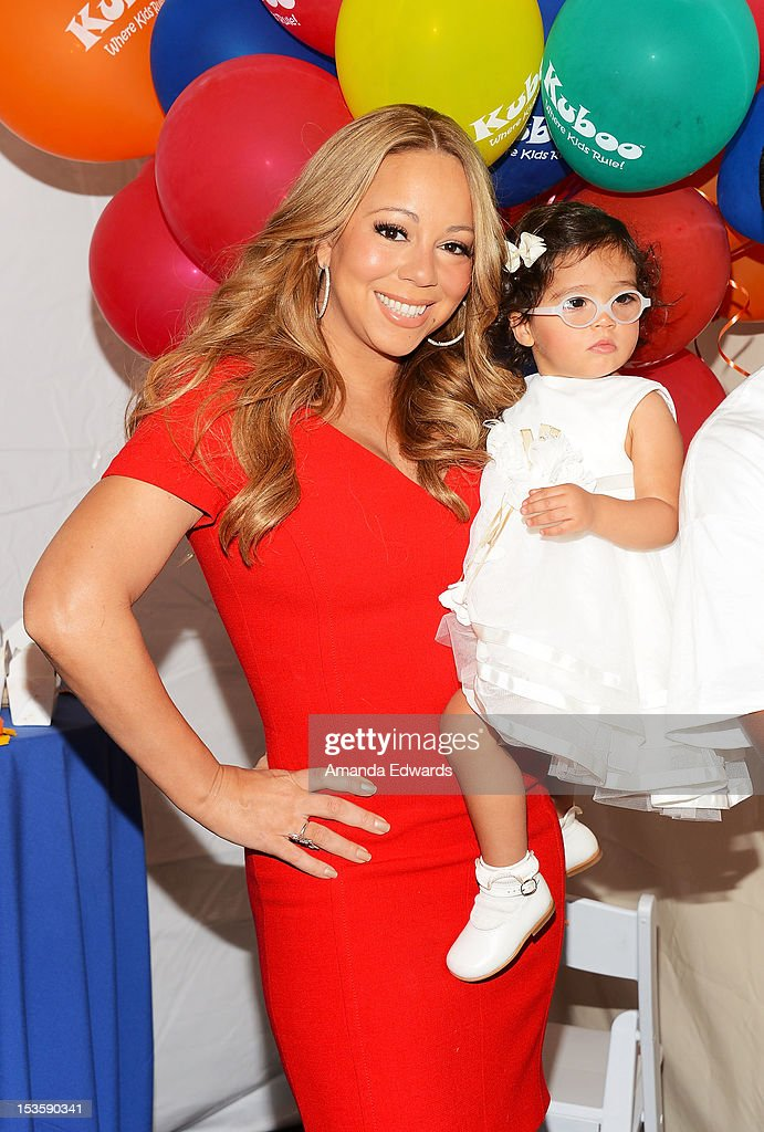 Recording artist <a gi-track='captionPersonalityLinkClicked' href=/galleries/search?phrase=Mariah+Carey&family=editorial&specificpeople=171647 ng-click='$event.stopPropagation()'>Mariah Carey</a> (L) and her daughter <a gi-track='captionPersonalityLinkClicked' href=/galleries/search?phrase=Monroe+Cannon&family=editorial&specificpeople=8561967 ng-click='$event.stopPropagation()'>Monroe Cannon</a> attend 'Family Day' hosted by Nick Cannon at Santa Monica Pier on October 6, 2012 in Santa Monica, California.