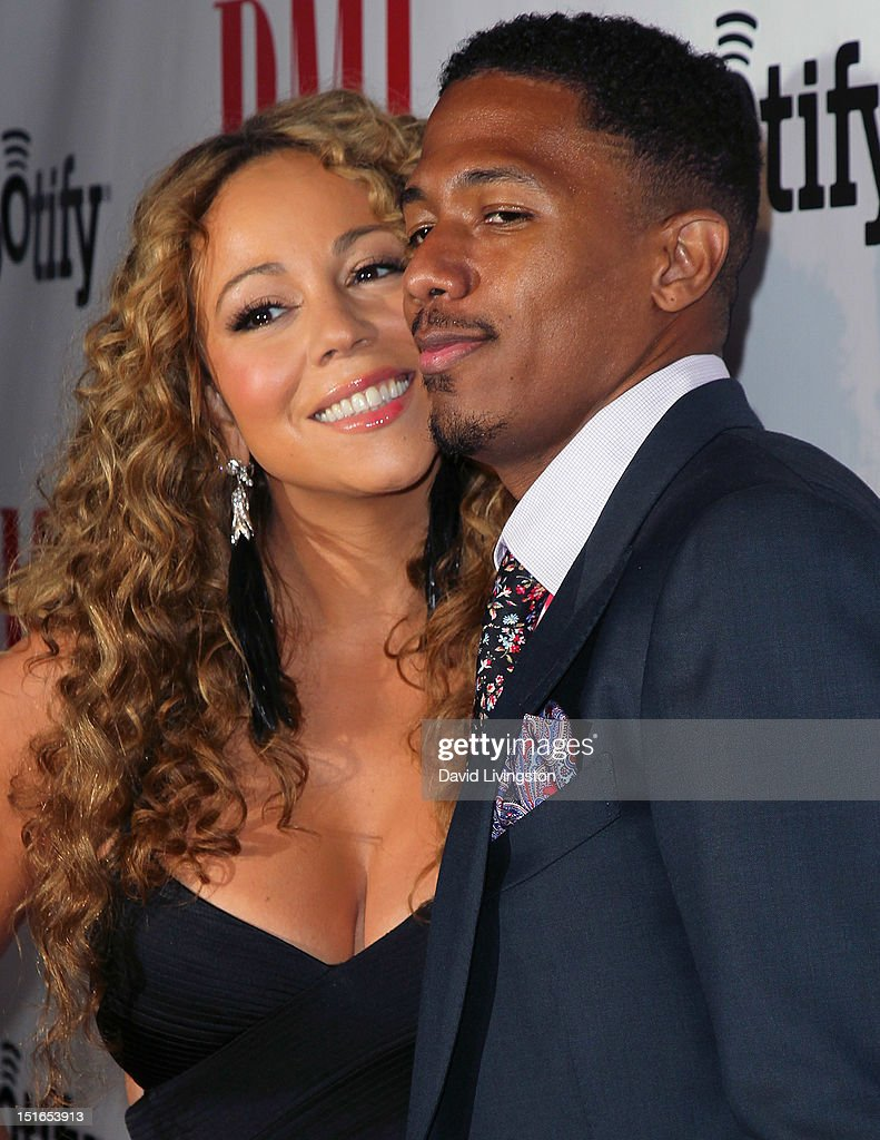 Recording artist Mariah Carey (L) and husband TV personality Nick Cannon attend the 12th Annual BMI Urban Awards at the Saban Theatre on September 7, 2012 in Beverly Hills, California.