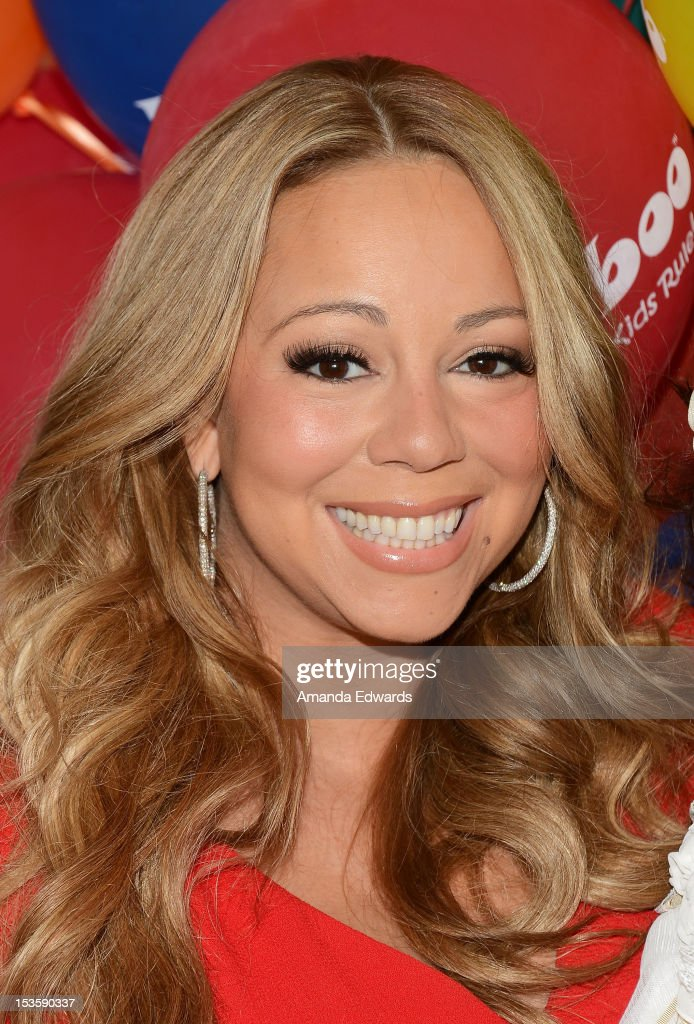 Recording artist <a gi-track='captionPersonalityLinkClicked' href=/galleries/search?phrase=Mariah+Carey&family=editorial&specificpeople=171647 ng-click='$event.stopPropagation()'>Mariah Carey</a> attends 'Family Day' hosted by Nick Cannon at Santa Monica Pier on October 6, 2012 in Santa Monica, California.