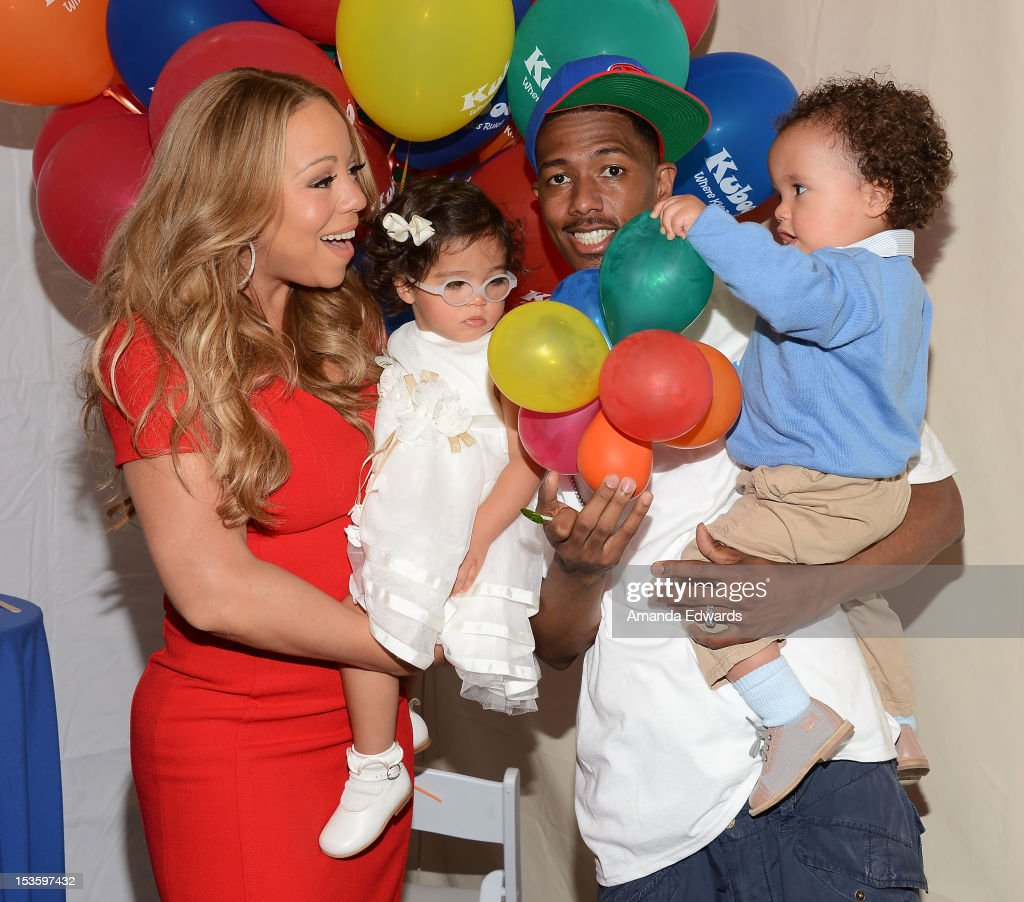 Recording artist <a gi-track='captionPersonalityLinkClicked' href=/galleries/search?phrase=Mariah+Carey&family=editorial&specificpeople=171647 ng-click='$event.stopPropagation()'>Mariah Carey</a>, her husband <a gi-track='captionPersonalityLinkClicked' href=/galleries/search?phrase=Nick+Cannon&family=editorial&specificpeople=202208 ng-click='$event.stopPropagation()'>Nick Cannon</a> and their children <a gi-track='captionPersonalityLinkClicked' href=/galleries/search?phrase=Monroe+Cannon&family=editorial&specificpeople=8561967 ng-click='$event.stopPropagation()'>Monroe Cannon</a> (L) and Moroccan Cannon attend 'Family Day' hosted by <a gi-track='captionPersonalityLinkClicked' href=/galleries/search?phrase=Nick+Cannon&family=editorial&specificpeople=202208 ng-click='$event.stopPropagation()'>Nick Cannon</a> at Santa Monica Pier on October 6, 2012 in Santa Monica, California.