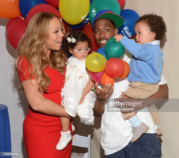 Recording artist Mariah Carey her husband Nick Cannon and their children Monroe Cannon and Moroccan Cannon attend 'Family Day' hosted by Nick Cannon...