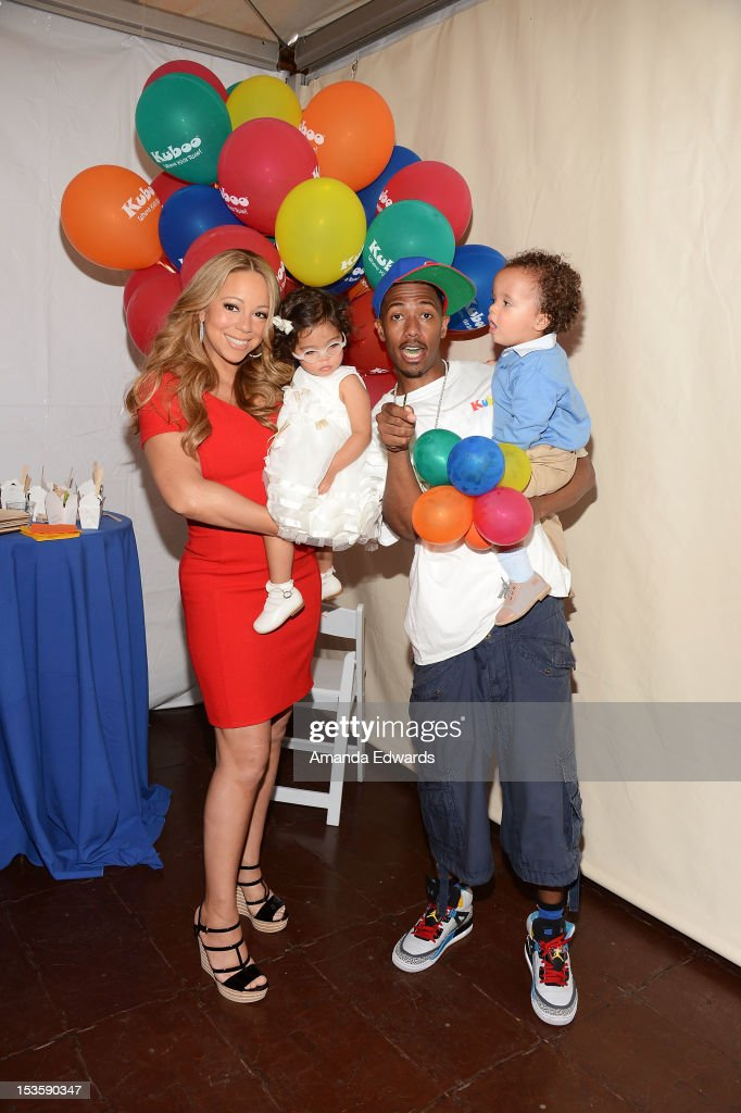 Recording artist <a gi-track='captionPersonalityLinkClicked' href=/galleries/search?phrase=Mariah+Carey&family=editorial&specificpeople=171647 ng-click='$event.stopPropagation()'>Mariah Carey</a>, her husband <a gi-track='captionPersonalityLinkClicked' href=/galleries/search?phrase=Nick+Cannon&family=editorial&specificpeople=202208 ng-click='$event.stopPropagation()'>Nick Cannon</a> and their twins <a gi-track='captionPersonalityLinkClicked' href=/galleries/search?phrase=Monroe+Cannon&family=editorial&specificpeople=8561967 ng-click='$event.stopPropagation()'>Monroe Cannon</a> (L) and Moroccan Cannon attend 'Family Day' hosted by <a gi-track='captionPersonalityLinkClicked' href=/galleries/search?phrase=Nick+Cannon&family=editorial&specificpeople=202208 ng-click='$event.stopPropagation()'>Nick Cannon</a> at Santa Monica Pier on October 6, 2012 in Santa Monica, California.