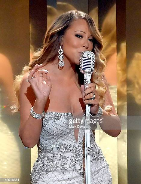 Recording artist Mariah Carey performs onstage during the 2013 BET Awards at Nokia Theatre LA Live on June 30 2013 in Los Angeles California